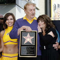 Buss and Addul pose as Los Angeles Lakers owner Jerry Buss receives a star on the Hollywood Walk of Fame in Hollywood