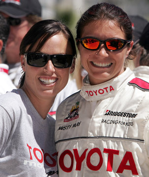 U.S. Olympic gold medalists Amanda Beard and Misty May hug at the 29th Annual Pro/Celebrity Race.