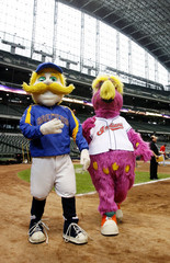 The Indian and Brewer mascots take a pre-game walk around Miller Park in Milwaukee, Wisconsin