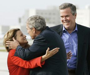 US President Bush greets Congresswoman Ros-Lehtinen and Governor of Florida Bush upon arriving in Miami