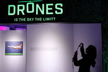 A guest photographs the entrance to the 'Drones: Is the Sky the Limit?' exhibition at the Intrepid Sea, Air & Space Museum in New York