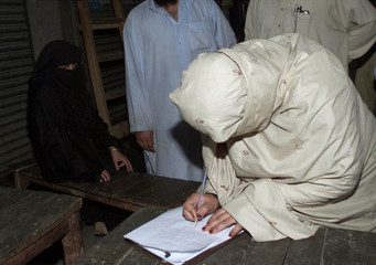 WIFE OF ISLAMIC MILITANT ASIF RAMZI SIGNS PAPERS TO RECEIVE HIS BODY INKARACHI.
