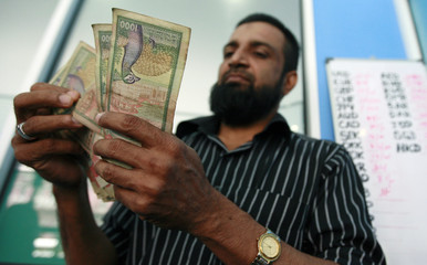 A man counts Sri Lankan Rupees in a money exchange in Colombo