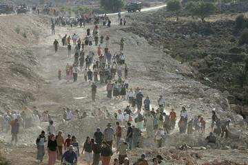 Right-wing Israeli activists walk near Efrat