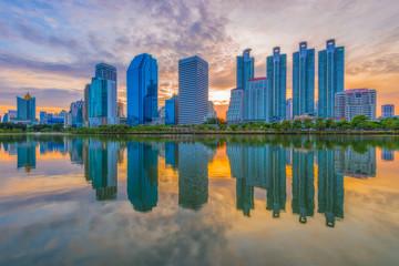 Bangkok citysape downtown at sunrise with reflection of skyline, Bangkok,Thailand.