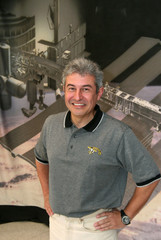 Brazilian astronaut Pontes stands against a mural of International Space Station in Houston