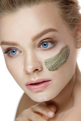 Beauty Face. Beautiful Woman With Stripe Of Clay Mask On Skin
