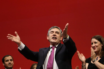 Britain's PM Brown gestures on stage during the annual Labour Party Conference in Brighton