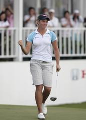 Suzann Pettersen of Norway celebrates after sinking a birdie putt to win the Honda LPGA Thailand