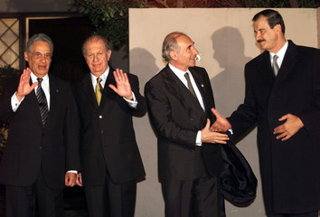 LEADERS OF BRAZIL CHILE ARGENTINA AND MEXICO SHAKE HANDS.