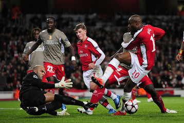 Standard Liege goalkeeper Sinan Bolat saves a shot from Arsenal's William Gallas during their Champions League soccer match in London