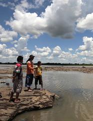 People fish at the Paraguay River near Asuncion