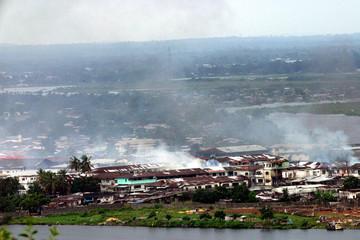 Smoke rises from rebel occupied neighbourhoods of Monrovia August 4, 2003. West African peacekeepers..