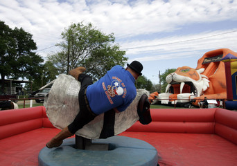 Heart of Texas Snake Handler falls off of a carnival ride at the Taylor Rattlesnake Sacking Championships in Taylor