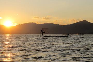 Fisherman at Inle lake posing for tourists