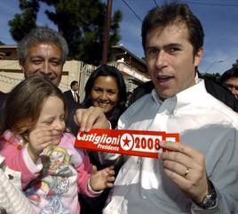 Paraguay's VP Castiglioni shows a bumper sticker during a rally in Asuncion