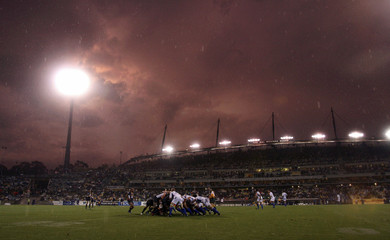 Storm clouds are seen over the stadium during the Super 14 rugby game between the Blues and the Brumbies in Canberra