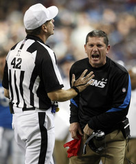 Detroit Lions head coach Jim Schwartz reacts on the sidelines next to NFL referee Jeff Triplette during the second half of their NFL football game against the Arizona Cardinals in Detroit