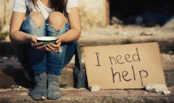 Poor woman begging for help on the street