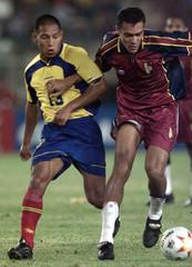 COLOMBIAS RESTREPO BATTLES FOR BALL WITH VENEZUELAS ALVARADO.