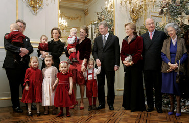 Belgium's royal family pose next to Christmas tree at Brussels Royal Palace