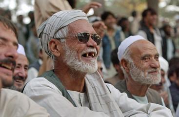 Afghans watch watch men wrestle in Herat's Taraghi park