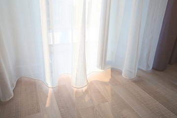 Window and beautiful curtains in flat