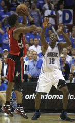 Toronto Raptors Bosh takes the last shot of the game as he is defended by Orlando Magic Howard during their NBA basketball playoff in Orlando