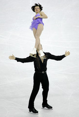 Russia's Petrova and Tikhonov perform their pairs short program in the European Figure Skating ...