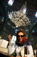 An Iranian woman votes for the Iranian presidential election in the Huseiniya Ershad mosque in Tehran.