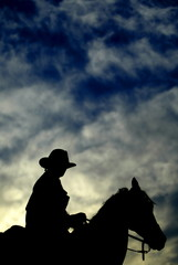 A cowboy actor is silhouetted as he takes part in a skit for tourists at the Cinema Studios Fort ...