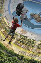 Parachutist  jumps inside a vast airship hangar hosting a Tropical Islands holiday resort near the eastern German village of Brand,