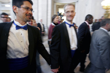Gaffney and Lewis walk inside San Francisco City Hall