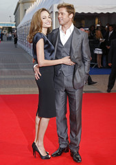 """Brad Pitt and Angelina Jolie pose as they arrive for the screening of """"The Assassination of Jesse James by the Coward Robert Ford"""" at the 33rd Deauville American Film Festival"""