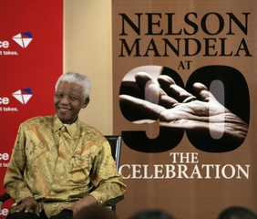 Former South African President Nelson Mandela smiles during the launch of postal stamps in Houghton
