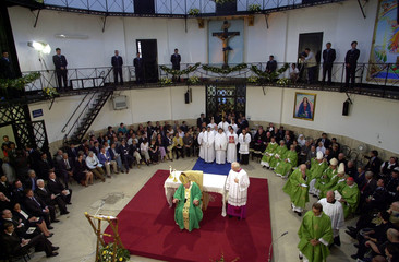 Pope John Paul II presides , July 9, over the holy mass on the atrium of Rome's Regina Coeli prison,..