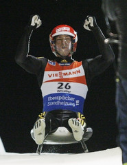 Germany's David Moller reacts after winning the Luge World Cup in Whistler