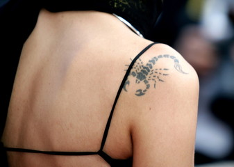 A guest arrives with a scorpion tattoo on her shoulder during arrivals for [Chinese director Wong Ka..