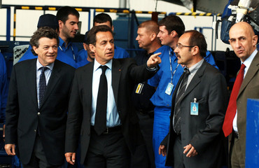 France's President Sarkozy and Borloo, Economic strategy and employment Minister, visit the A330-A340 assembly line in Toulouse