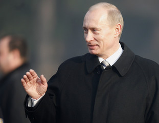 Russian President Putin waves to well-wishers during official welcoming ceremony in Sofia