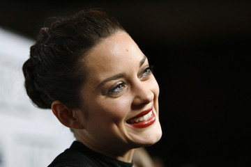Marion Cotillard smiles at the 33rd annual Los Angeles Film Critics Association Awards in Los Angeles