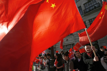 A pro-China protester waves a flag outside the Chinese embassy in central London