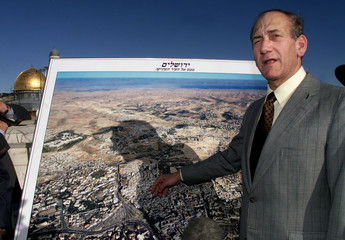 Jerusalem Mayor Ehud Olmert explains details of the Old City on a map of Jerusalem overlooking the D..