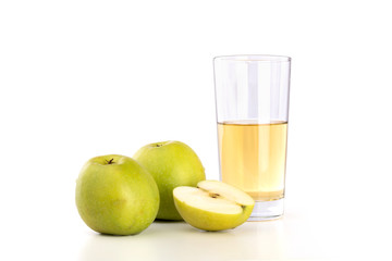 Glass of apple juice and apples on white background