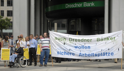 Employees of Dresdner Bank and Verdi union members demonstrate outside the Dresdner Bank headquarters in Frankfurt