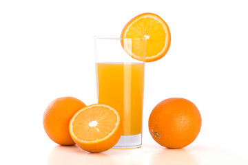 Glass of orange juice and oranges on white bacground