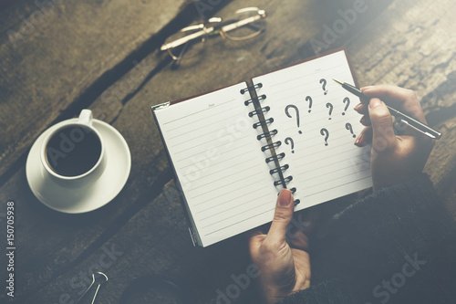 Quot woman writing question mark stock photo and royalty free