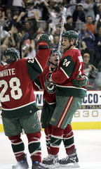 Wilds Bouchard and Boogaard celebrate goal against Ducks