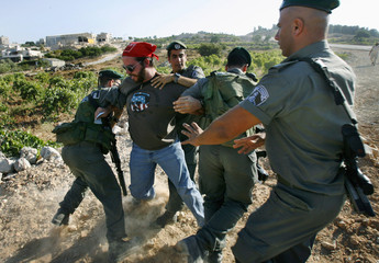 Israeli border police officers scuffle with right-wing activist near Efrat