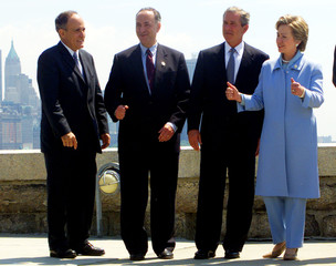 PRESIDENT BUSH STANDS WITH NEW YORK POLITICIANS AT ELLIS ISLAND.